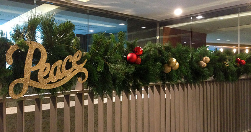 An image of garland and ornaments placed along a guard rail